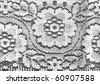 white lace on black background - stock photo