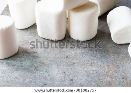white marshmallow pieces on wood background