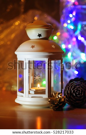 white metal candlestick and blurred colorful background