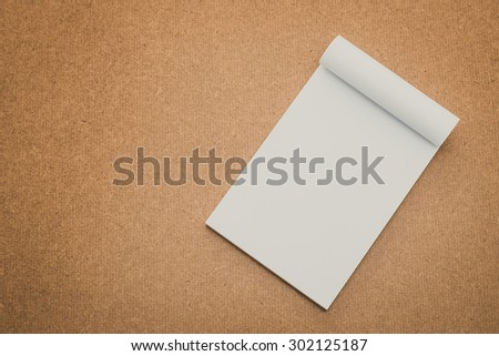 White paper mock up on wood background - vintage filter