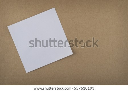 white paper on left side of brown paper background