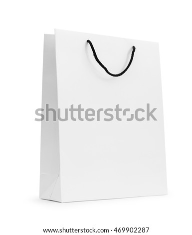 White paper shopping bag. Luxury paper bag for retail and merchandise. Paper bag isolated with clipping path