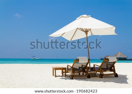 White parasol and beautiful beach,Maldives