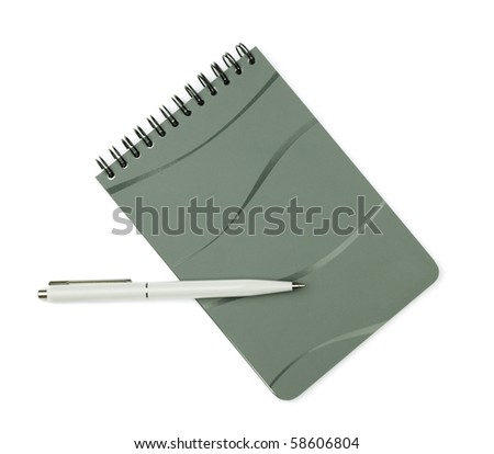 White pen on closed notepad. Isolated on white background
