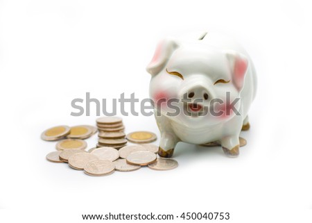 White pig money box and coins,save money concept