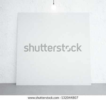 white poster in room with ceiling lamp