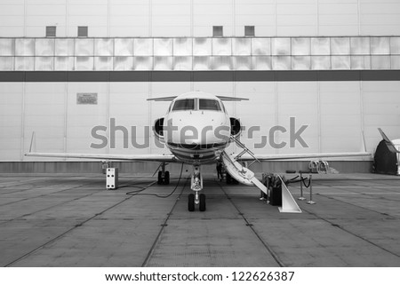 White reactive private jet, front landing gear and ladder