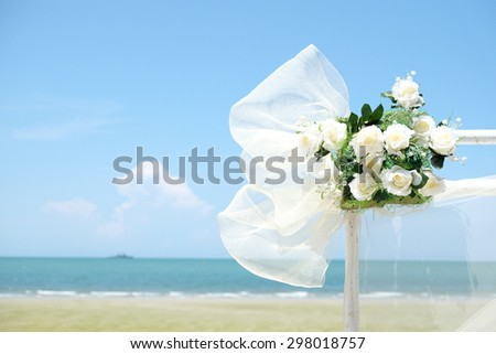 white rose and sea