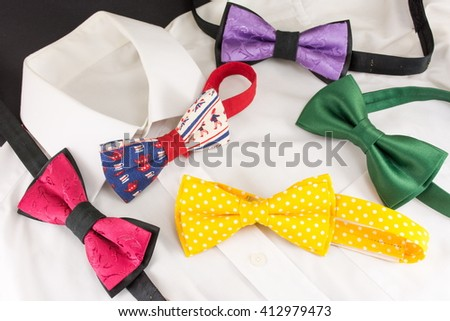 white shirt and various colorful bow ties