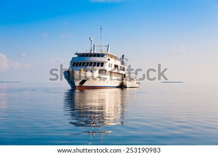 white  speed ship in sea tropical  Maldives  romantic  atoll island paradise luxury  resort about coral reef amazing  fresh  freedom snorkel adventure