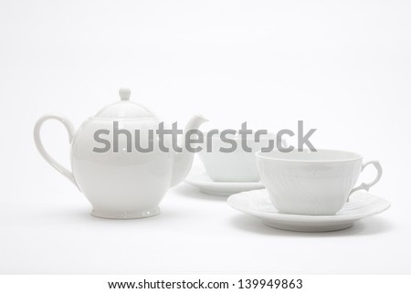 White tea pot and cups