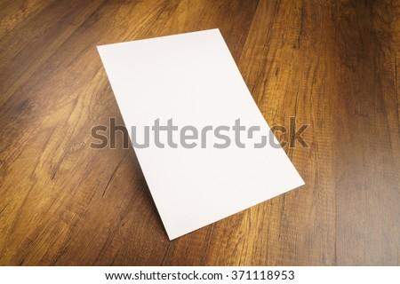 cardboard brochure holder template - blank brochure on wooden desk template stock photo