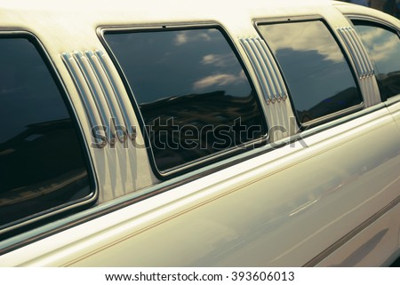 White wedding limousine long side view with windows