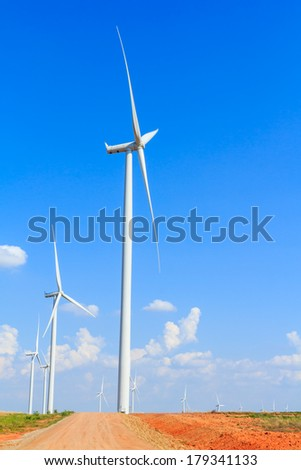 White wind turbine generating electricity in countryside Thailand