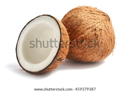 whole coconut fruit with half on a white background