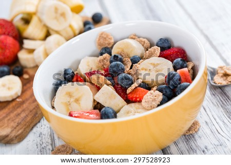 Wholemeal Cornflakes with fresh Fruits on a wooden background