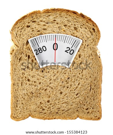 Wholesome slice of bread as weighing scale isolated on white