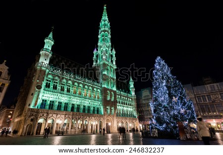 Wide angle night scene of the Grand Place, the focal point of Brussels, Belgium. The Town Hall (Hotel de Ville) is dominating the composition with its 96m tall spire.