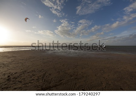 Wide angle view of kite surfers from the mud flats