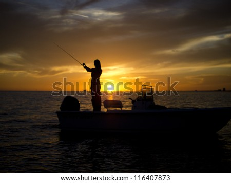 Wide angle Woman fishing Mississippi Gulfport Biloxi Sunset