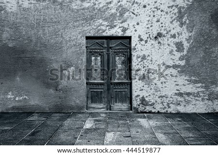 Wide grunge vintage background with old door, empty room interior as backdrop