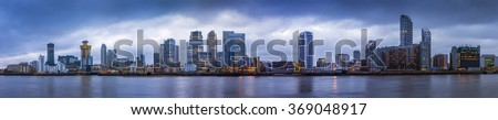 Wide panoramic skyline of Canary Wharf, the worlds leading financial district at blue hour - London, UK