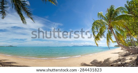Wide view of tranquil tropical island beach