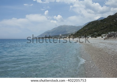 Wild rocky coast of the White Sea sunlit in Albania