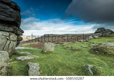 wilderness and adventure in British Dartmoor on overcast rainy day