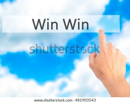 Win Win - Hand pressing a button on blurred background concept . Business, technology, internet concept. Stock Photo