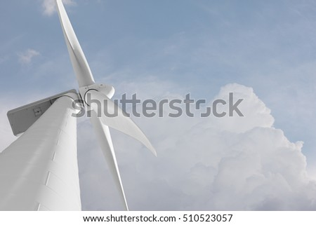 Wind mill against clouds sky with copyspace - renewable energy production with wind generator modern technology to produce eletricity with the power of wind