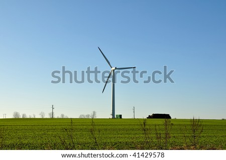 Wind turbine on farm.