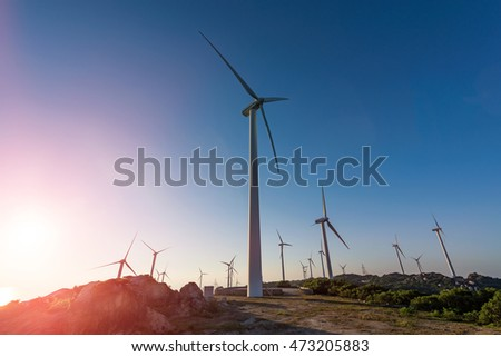 Wind turbines on the coast in the production of green energy