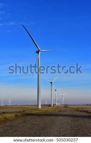 Wind turbines on the northern plains generating clean energy.