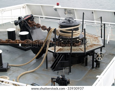 Windless or anchor winch on a large ferry used to winch anchor chain and lines used when docking.  This one is hydraulically driven
