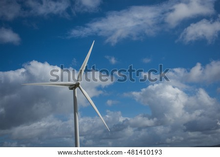 Windmill against a blue sky and white clouds