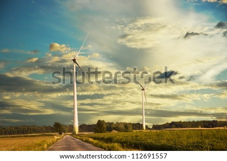 Windmill at sunset with a cloudy sky