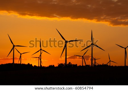 Windmill silhouette on suset background