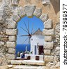 Windmill through an old Venetian window, Greece - stock photo