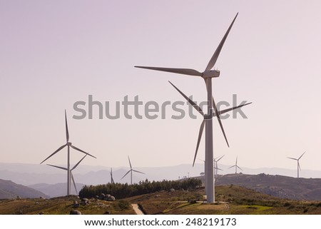 Windmills at windfarm - renewable electric energy production