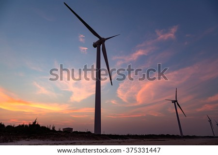 Windmills in the evening the red cloud background