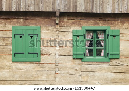 Windows on traditional log cabin