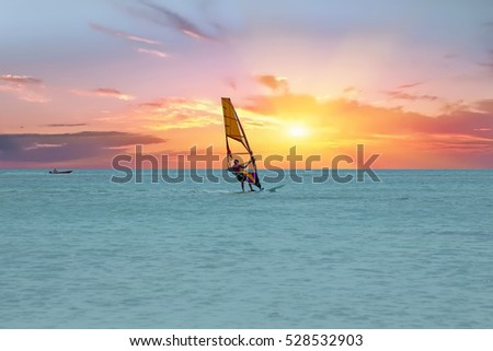 Windsurfer at Aruba island on the Caribbean Sea at a beautiful sunset