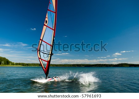 Windsurfing lessons on the lake, fall into the water