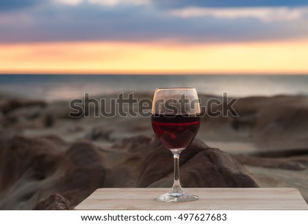 wine and candy by the beach during sunset. image contain soft focus and blur due to shallow DOF.
