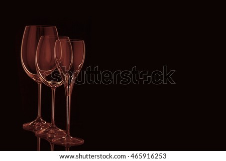 Wine and champagne glass set isolated on black background. Toned red