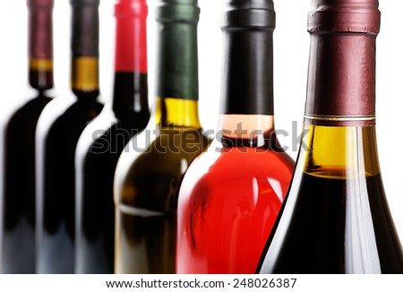 Wine bottles in row close-up