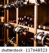 Wine cellar full of wine bottles - stock photo