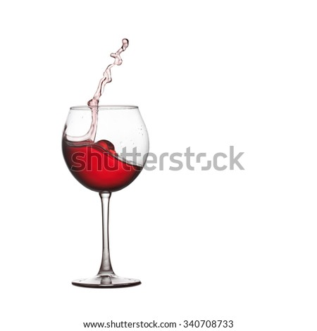 Wine glass splash. Red drink splashing into crystal glass., close-up, white background. copy space.