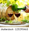 Wine. Red Wine and Cheese. Romantic Lunch Outdoor. Pouring Wine close-up. Outdoors - stock photo